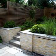 Waterwall feature with Ivory quartz cladding in W4 garden