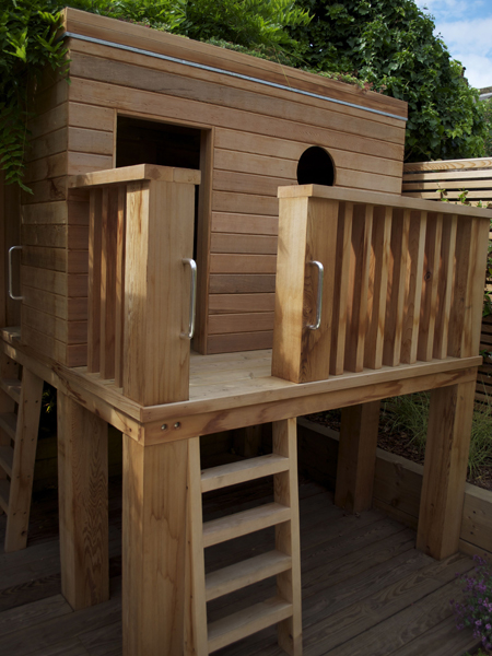 Cedar children's raised play den with green roof