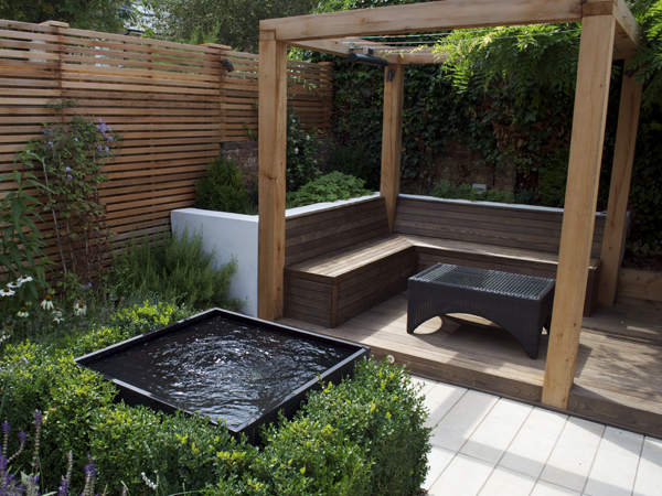 Bespoke Cedar hardwood cube design pergola with integrated seating