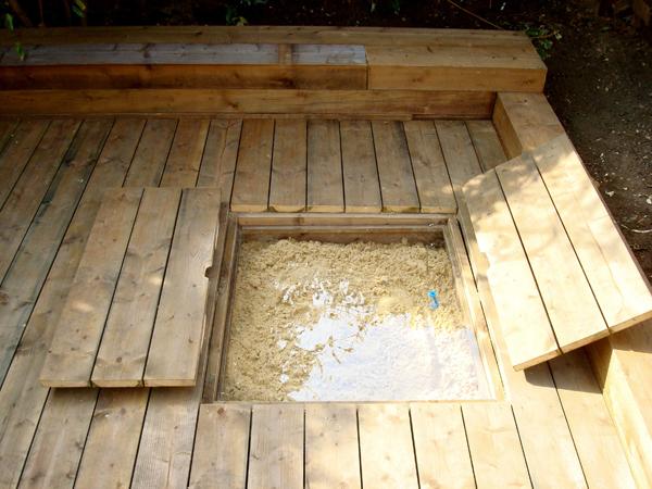 Softwood deck sandpit with lids