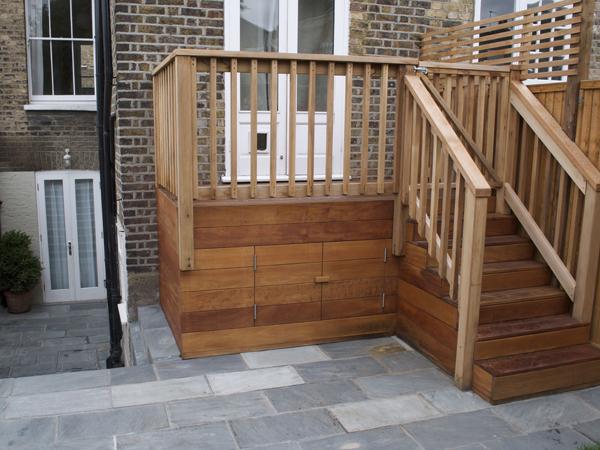 Garapa hardwood raised deck with hidden storage cupboard