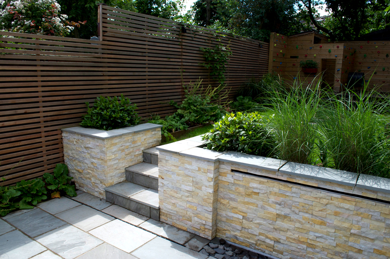 Waterwall feature with Ivory quartz cladding in W4 garden
